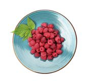 Plate with ripe raspberries on white background. Top view Royalty Free Stock Image