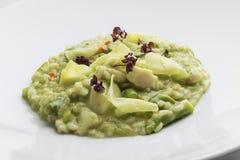 Dish of Risotto Carnaroli with asparagus, scallops and ginger. Plate of Risotto Carnaroli with asparagus, scallops and ginger Stock Photo