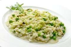 Plate of Risotto with Clams and Peas. In white plate Royalty Free Stock Photo