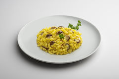 Plate of risotto with saffron and mushrooms Royalty Free Stock Image