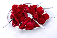 Plate of roses. With spoons Stock Photo
