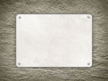 Plate on rough wall background Royalty Free Stock Photos