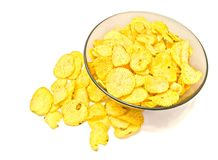 Plate with ruffles chips. Plate with ruffles potato chips on white closeup Royalty Free Stock Image