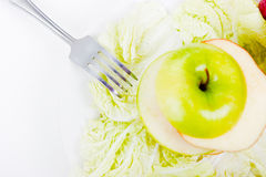 Plate with salad and apples Stock Image