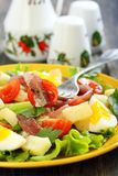 Plate with salad and fork. Stock Photo