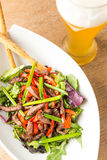 Plate of salad and light bear Stock Image