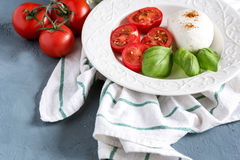 Plate with salad Mozarella tomato basil Italian food Healthy dinner. Plate with salad Mozarella tomato basil Italian food Royalty Free Stock Photography