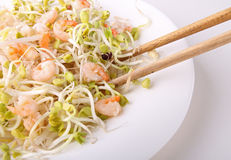 Plate of salad with shrimp, and soya bean. And chopsticks Royalty Free Stock Photos