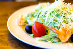 Plate with salad, tomato and olive Royalty Free Stock Image