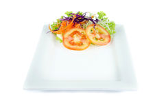 Plate and salad on top plate on white background Royalty Free Stock Photography