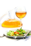 Plate of salad and wine glass Royalty Free Stock Images