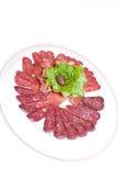 Plate with salami Stock Photos