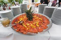 Plate of salmon with ananas Stock Image