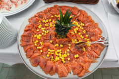 Plate of salmon with ananas Stock Images