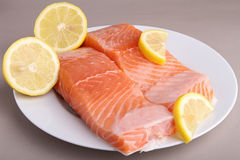 Plate of salmon and lemon Royalty Free Stock Photo