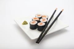 Plate of salmon maki sushi with chopsticks Royalty Free Stock Photo