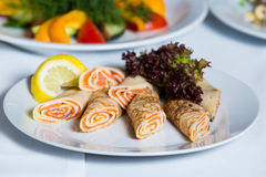 Plate with salmon pancakes Stock Image