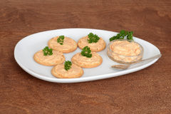 Plate of salmon pate crackers Stock Images