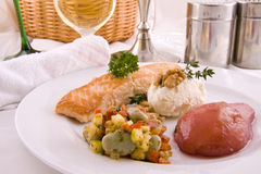 A plate with salmon and pear Stock Images