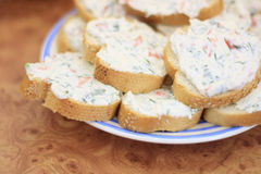 Plate of sandwiches. Close up of a plate of sandwiches with cheese and vegetable spread Royalty Free Stock Images