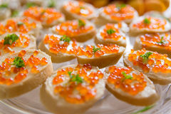 Plate with sandwiches with red caviar Stock Image