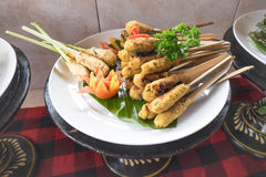 Plate of satay. Plate of chicken and tofu satay sticks Stock Images
