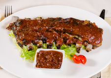 Plate of Saucy Barbecue Pork Ribs Royalty Free Stock Photos