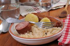 Plate of sauerkraut garnished on a table stock images