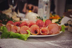Plate of sausage meats on wedding table Stock Images