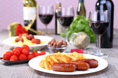 Plate with sausage and potato. Sausage and potato with food background Royalty Free Stock Photos