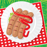 Plate with sausages Stock Photography
