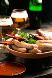 Plate of sausages and glass of beer Royalty Free Stock Image