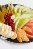 Plate of season cut fruit and berries. salad. Diet, healthy on the black - breakfast, weight loss concept. closeup. A plate of season cut fruit and berries Stock Photo