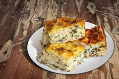 Plateful Of Serbian Cheese Spinach Pie Zeljanica Slices Set On Old Weathered Wooden Garden Table Surface. Plate of freshly baked Serbian traditional Spinach Royalty Free Stock Photos