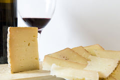 Plate with a serving of cheese with a glass of red Royalty Free Stock Photo