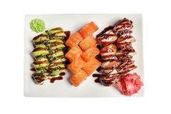 Plate with set of delicious sushi rolls. On white background Royalty Free Stock Photo