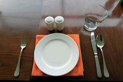 Plate set on dining table Stock Image