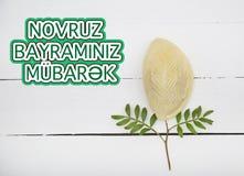 Plate with shekerbura and pakhlava as Novruz Holiday. Celebration on background with wordings Novruz Bayraminiz Mubarak stock photos