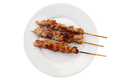 Plate with shish kebab on skewers Stock Images