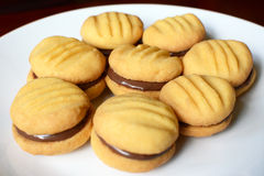 Plate of shortbread biscuits with chocolate filling Royalty Free Stock Image