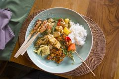 Plate of typical Balinese, Thai, Indonesian food with chicken sa stock images