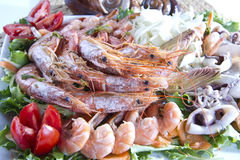 Plate of shrimp. Second dish of Mediterranean cuisine, shrimp and vegetables royalty free stock photos