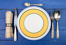 Plate with silver cutlery Stock Photo