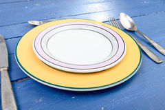 Plate with silver cutlery on an old table Royalty Free Stock Images