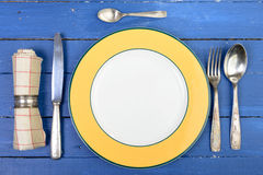 Plate with silver cutlery on an old table Royalty Free Stock Photos