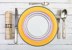 Plate with silver cutlery on an old  table Stock Photo