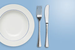 Plate and silverware isolated Royalty Free Stock Photography