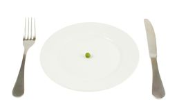 Plate with a single green pea isolated Stock Photo