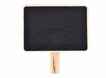 Plate of slate for writing with wooden base on white Royalty Free Stock Images