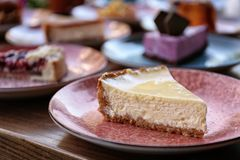 Plate with slice of cheesecake stock photo